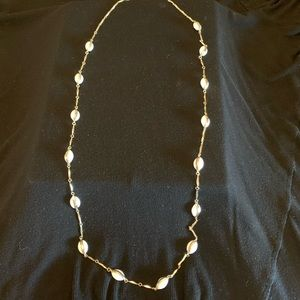 Long white and gold necklace